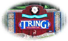Yes, Tring does exist, and here's a picture of it's Town Boundry Shild